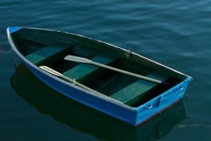143938272-rowing-boat-in-still-waters-gettyimages